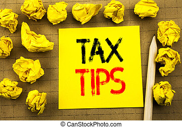 Tax Tips. Business concept for Tip Forn Taxes written on sticky note paper on the vintage background. Folded yellow papers on the background