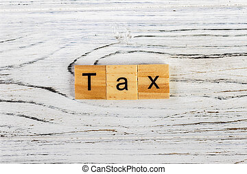Tax word made with wooden blocks concept