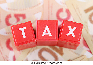 Tax word on money background