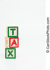 TAX word wooden block arrange in vertical style on white background and selective focus