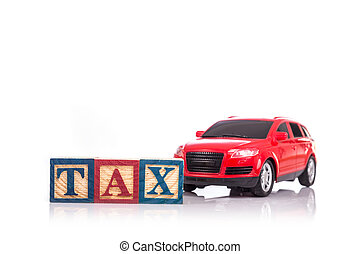 """""""TAX"""" write in colorful wood alphabet blocks and red model car isolated on white"""