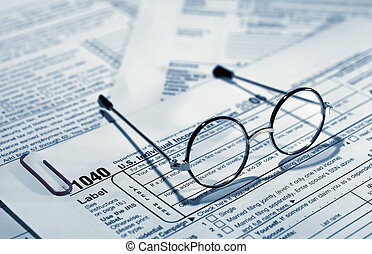 Taxes - Photo of of Eyglasses on Top of Tax Forms - Tax...