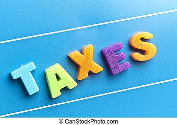 Taxes word on blue board