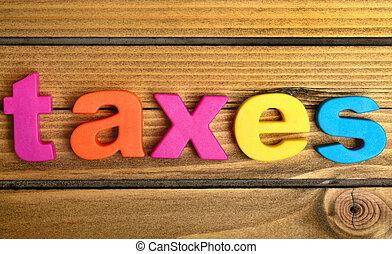 Taxes word on table
