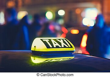 Taxi car on the street at the night