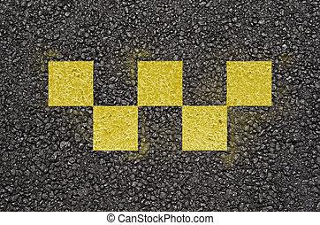 Taxi checks symbol on asphalt