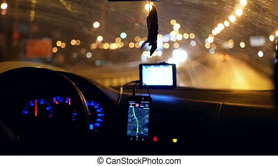 Taxi gps driver night - GPS gadgets used when driving a car....