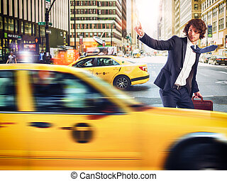Taxi in the city - Businessman stopped a taxi in the city