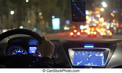 Night taxi ride in traffic city navigation driver hand