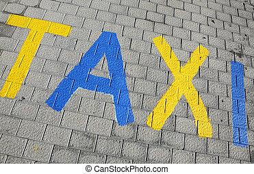 taxi parking sign on a cobbled street maspalomas gran canaria