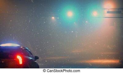 Taxi Passes At Night As Snow Falls