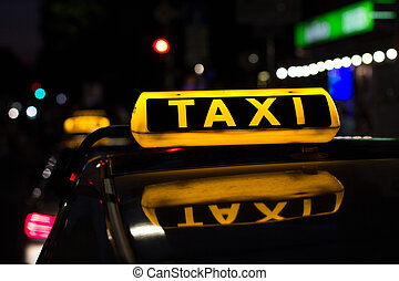 taxi sign at night , taxi cars