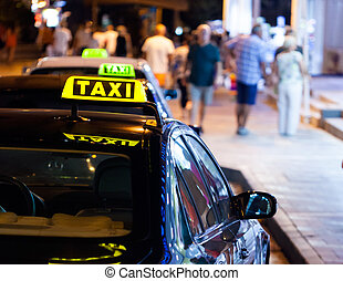 Taxi sign at night