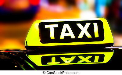 Taxi sign on the roof of a car close-up