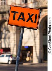 taxi sign orange