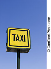 Taxi sign with blue sky