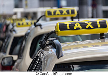 taxi signs, taxi cars waiting in line