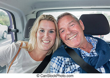 Taxi with passengers father and daughter