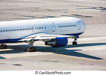 Taxiing airplane on the airport apron