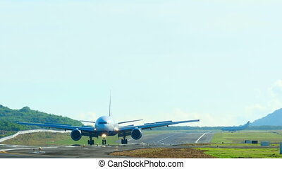 Taxiing - Boeing 777 taxiing on the runway, International...