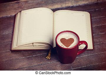 taza de café, con, cuaderno