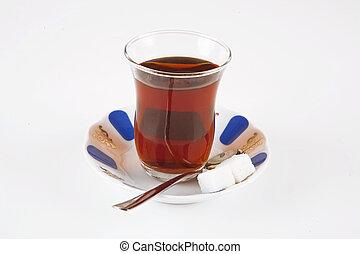 A glass of tea. Turkish tea. Refraction on tea spoon