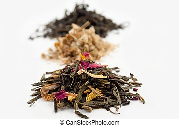Tea - An image of three heaps of various tea
