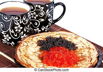 Tea and a pancakes with caviar