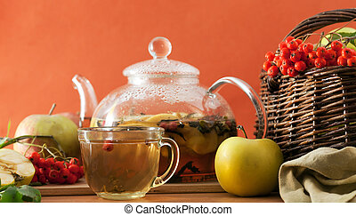 Tea and apples - Tea kettle and apples on the table on an...