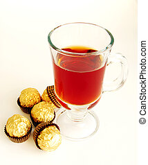 tea and candies on a white background