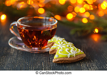 tea and cookies with lights in background, selective focus