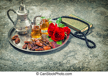 Tea and red rose flower, holy book quran and rosary. Ramadan...