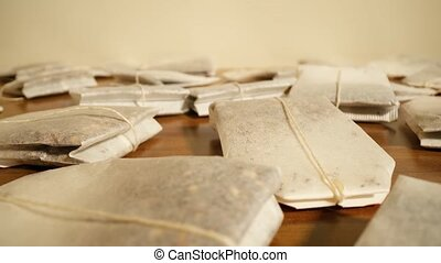 Tea bags scattered on the table