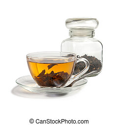 Tea brewed in a cup and standing next to the bank with a dry tea. Isolated on white