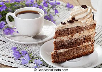 Tea, cake, wild flowers bells on the old table