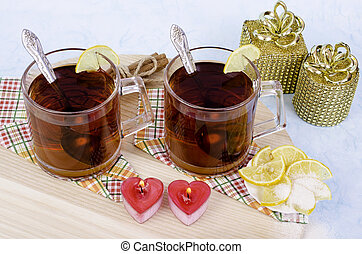 Tea candles in the form of hearts and gifts.