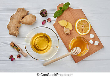 Tea composition on wood background, flat lay.