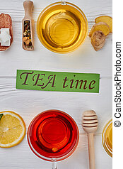 Tea composition on wooden background, flat lay.