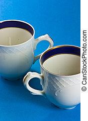 Tea cup on blue