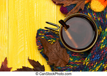 Tea cup with citrus making autumn composition, top view.