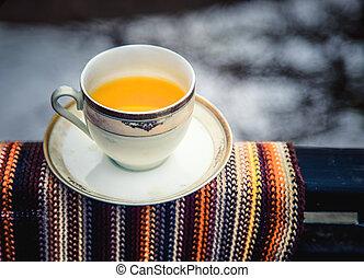Tea cup with yellow lemon tea. Background use