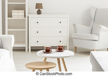 Tea cups in white room