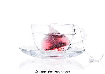 Tea dissolving in hot water. - Tea Bag In Transparent Cup...