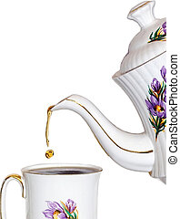 Tea drop - Pouring a cup of tea,isolated
