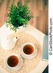 Tea for two - The above view of a tea set with plant and ...