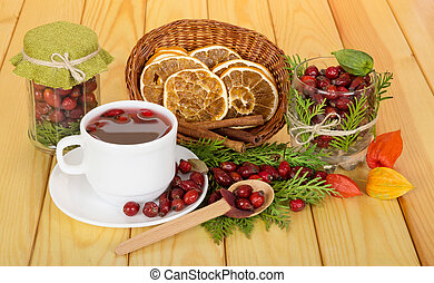 Tea hips, dried orange, cinnamon on wooden table - Tea from ...