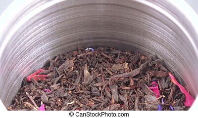 Tea in an iron jar with a lid