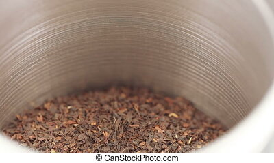 Tea in an iron jar with a lid - Rotating the iron box with...