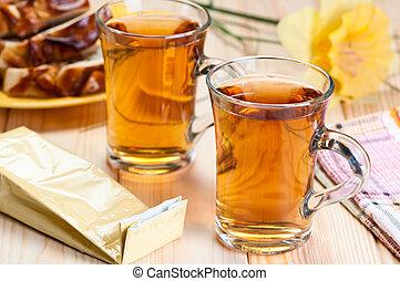 Tea in glass mugs.