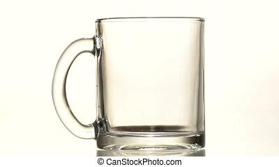 Tea is poured into a mug